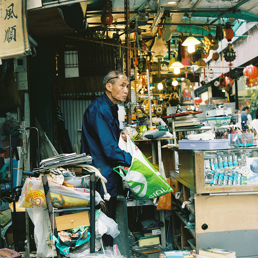 Old shopkeeper tending to his stall, Central, Hong Kong